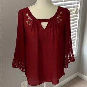 Anthropologie Maeve wine cutout sleeve blouse